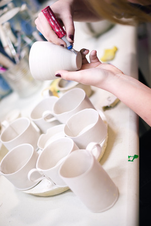 Pottery artist cutting egdes