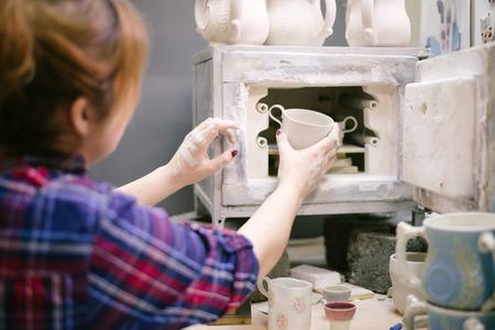 sculptor: Pottery artist baking ware