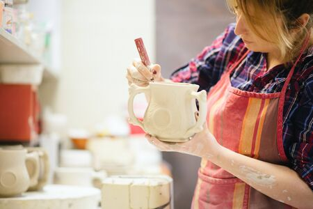 Pottery artist cutting edges Stock Photo - 37058087