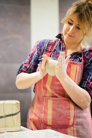 Pottery artist kneading clay 免版税图像 - 37058076