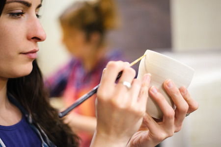 Pottery artist painting