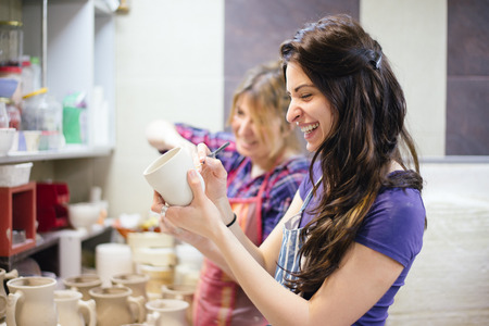 ceramic: Pottery artist painting