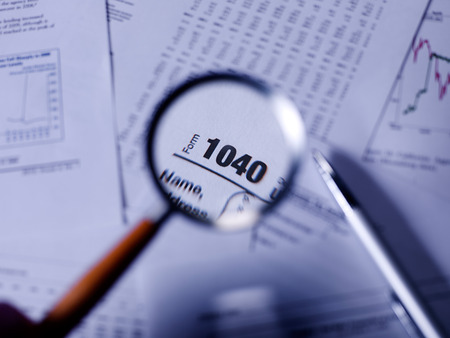 taxable: Tax Form with magnifying glass