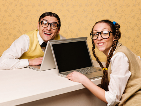 Young nerds sitting at the desk 스톡 콘텐츠