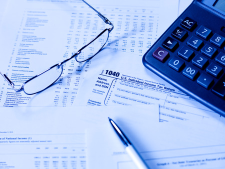 taxable income: Tax Form with glasses Stock Photo