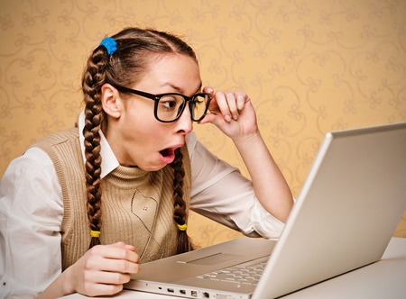 ugly woman: Female nerd looking at the laptop