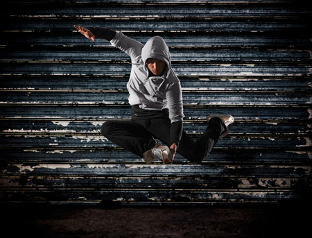 hip hop girl: Modern hip-hop style teenage man jumping