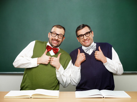 Two male nerds thumbs up
