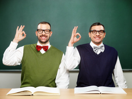 Two male nerds say OK