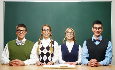 Four nerds in front of blackboard Stock Photo