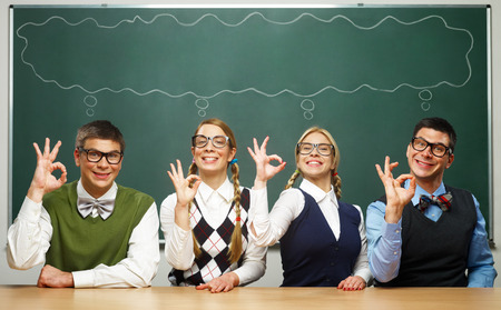 Nerds showing OK signs