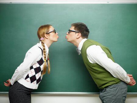 Nerd couple kissing