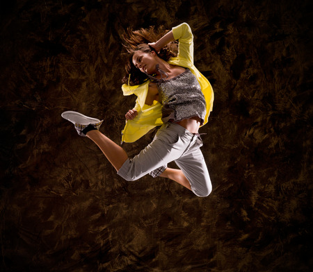 hip hop style: Modern hip-hop style teenage girl jumping