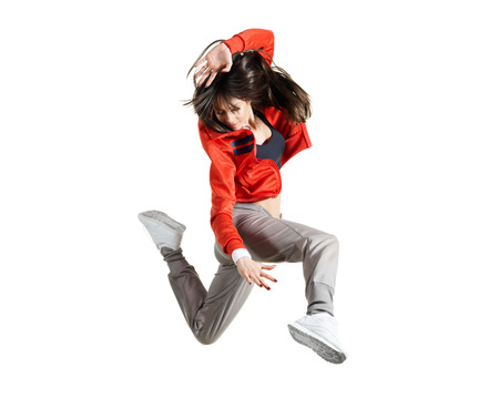 Modern hip-hop style teenage girl jumping
