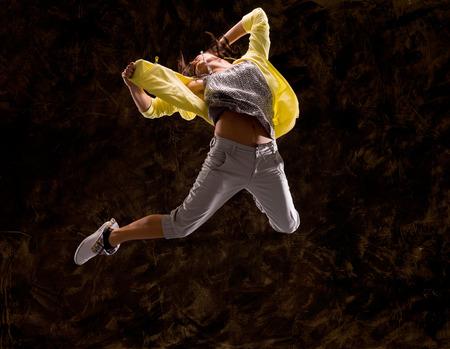 woman dancing: Modern hip-hop style teenage girl jumping