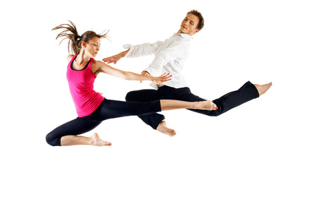 Modern ballet dancers, male and female in the jump