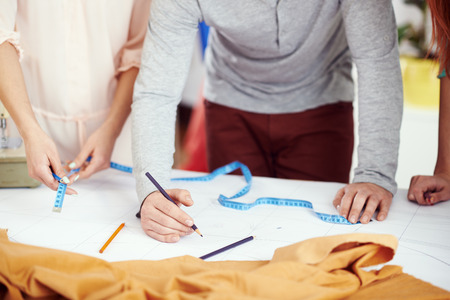 sewing pattern: Young designers working on a sewing pattern Stock Photo