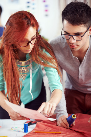 alteration: Designers working on the dress plan Stock Photo