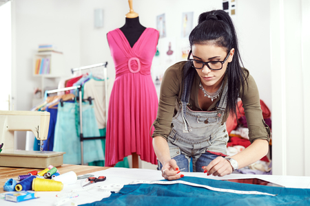 Designer drawing on a textile material