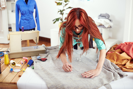 textile designer: Designer drawing on textile material Stock Photo