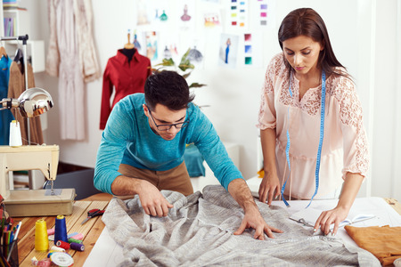 Two young designers measure material