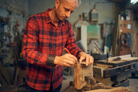Carpenter measuring wood Stock Photo