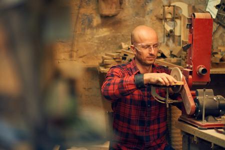 sander: Carpenter using circular sander Stock Photo
