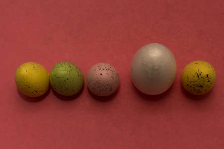 Colorful Easter eggs in a row. One egg larger than the others.