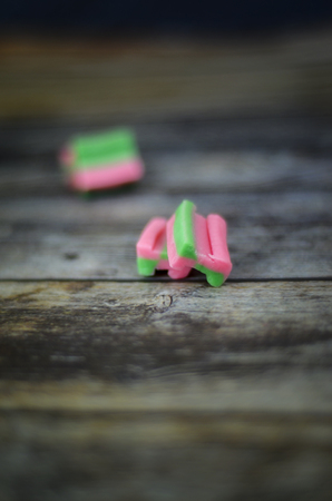 Pink and green chewing gum