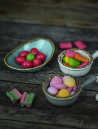 Many different candy on wooden background. Top view 版權商用圖片
