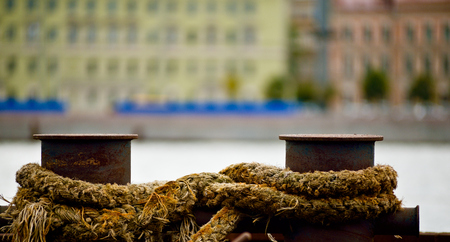 mooring bollards: Bollards at the port with ropes from the moored vessel