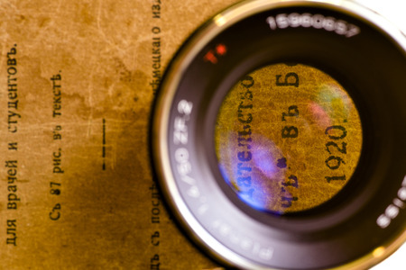 etude: Lens and old book Stock Photo