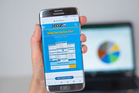 Barcelona / Spain 06 10 2019: Carfax web site on mobile phone screen. Mobile version of Carfax company web page on smartphone. Official web page of Carfax. 報道画像