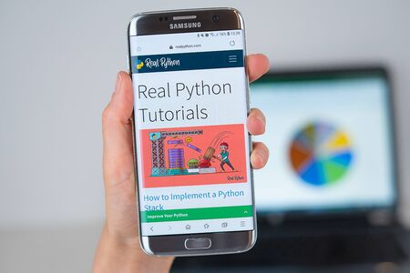 Barcelona / Spain 06 10 2019: Real Python web site on mobile phone screen. Mobile version of Real Python company web page on smartphone. Official web page of Real Python.