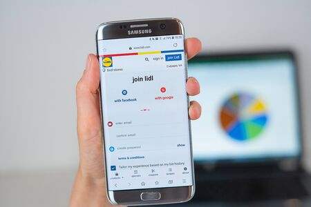 Barcelona / Spain 06 10 2019: Lidl web site on mobile phone screen. Mobile version of Lidl company web page on smartphone. Official web page of Lidl. 報道画像