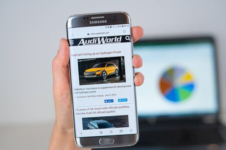 Barcelona / Spain 06 10 2019: AudiWorld web site on mobile phone screen. Mobile version of AudiWorld company web page on smartphone. Official web page of AudiWorld. 報道画像
