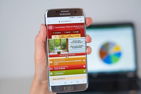 Barcelona / Spain 06 10 2019: Canandaigua National Bank web site on mobile phone screen. Mobile version of Canandaigua National Bank  web page on smartphone. Official web page of CNBank. 報道画像