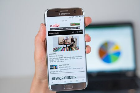 Barcelona / Spain 06 10 2019: Alibi web site on mobile phone screen. Mobile version of Alibi company web page on smartphone. Official web page of Alibi.