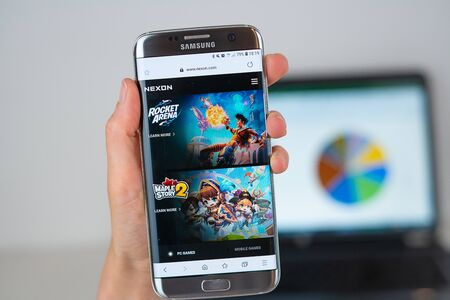 Barcelona / Spain 06 10 2019: Nexon web site on mobile phone screen. Mobile version of Nexon company web page on smartphone. Official web page of Nexon 報道画像