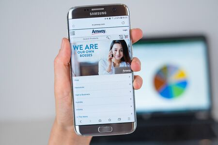 Barcelona / Spain 06 10 2019: Amway web site on mobile phone screen. Mobile version of Amway company web page on smartphone. Official web page of Amway. 報道画像