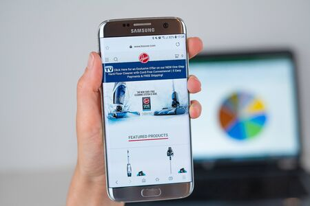 Barcelona / Spain 06 10 2019: Hoover web site on mobile phone screen. Mobile version of Hoover company web page on smartphone. Official web page of Hoover. 報道画像
