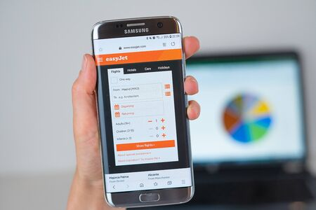Barcelona / Spain 06 10 2019: EasyJet web site on mobile phone screen. Mobile version of EasyJet company web page on smartphone. Official web page of EasyJet.