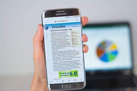 Barcelona / Spain 06 10 2019: VirtualBox web site on mobile phone screen. Mobile version of VirtualBox company web page on smartphone. Official web page of VirtualBox.