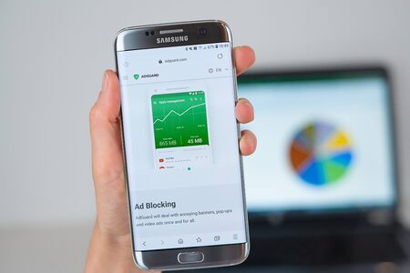 Barcelona / Spain 06 10 2019: Adguard web site on mobile phone screen. Mobile version of Adguard company web page on smartphone. Official web page of Adguard. 報道画像