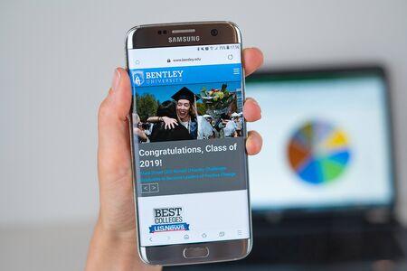 Barcelona  Spain 06 10 2019: Bentley University web site on mobile phone screen. Mobile version of Bentley University web page on smartphone. Official web page of Bentley University. Editorial
