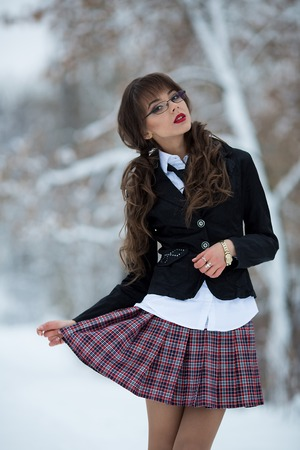 checkered skirt: The awesome teacher, student, woman in a suit and a checkered skirt, wearing spectacles also looks is proud forward and it is self-confident, glasses Stock Photo