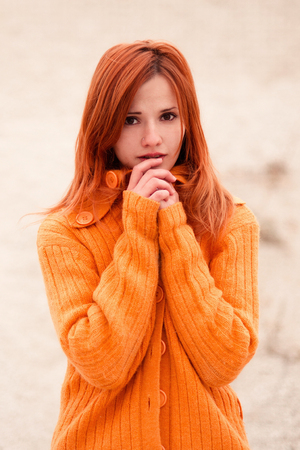 redhaired: a red-haired woman stands a lonely