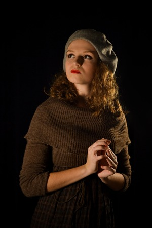 french model: The portrait of notable,caucasian,self-assured,proud,well-mannered,fashionable,glamorous pretty,important,parisian,french,colourful with good manners girl,model in a gray beret on the black background