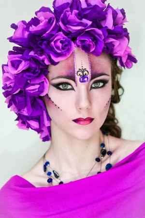inaccessible: Gorgeous,exquisite,striking,stunning,dazzling girl with rich.The girl has extraordinary,professional,bright,interesting,creative make-up,body painting,big bright and beautiful wreath,beads,jewelry,necklace.Professional make-up artist,fashion expert.