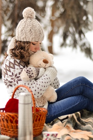 Beautiful, attractive, cute, lovely girl, kid, babe, hugging, embracing cute, white, tiny, small teddy bear, winter, snow, gift, year, sweater, lantern, cold, forest, background, holiday, fun, joy, childhood, xmas, celebrate, box, merry, snowflake, fir